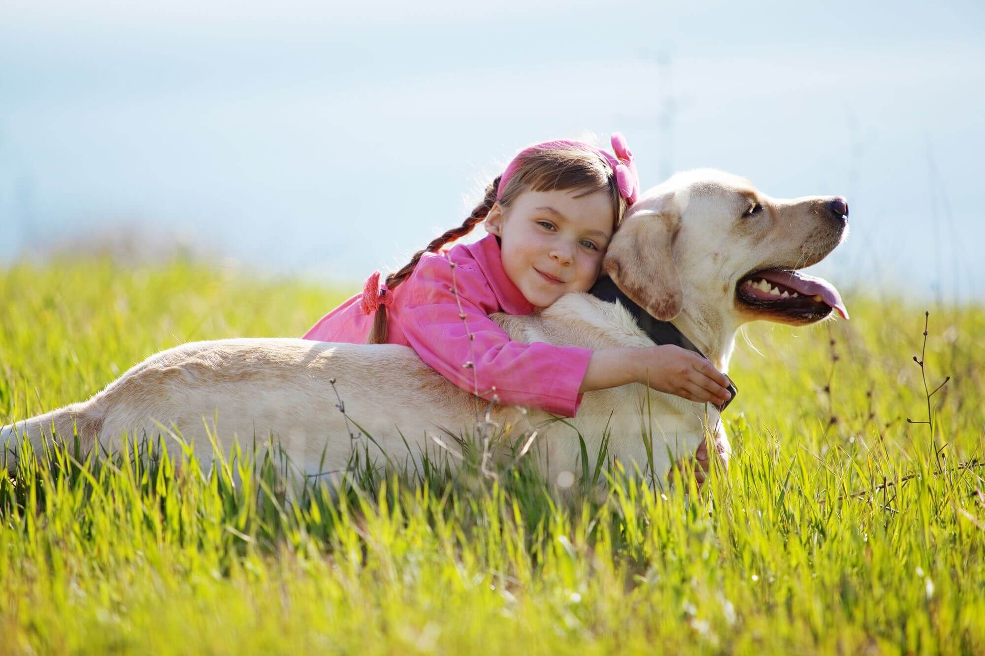 Young Girl Holding Pet Dog